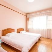 青島蜜桃小丸子的海景屋酒店式公寓